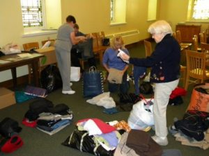 sorting clothing for Project SHARE